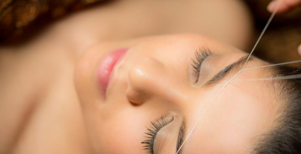 THREADING is a method where a skilled practitioner holds a twisted length of thread in one hand while the other end is held in the mouth or in the other hand. Then hairs are trapped in the twisted thread and pulled out. Although this can be performed by oneself, professionals are recommended .