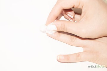 3) Rub the q-tip back and forth over your nail until it starts to disappear.