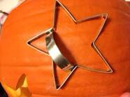 All you need is a cleaned out pumpkin, a rubber mallet, and any shape of cookie cutter.