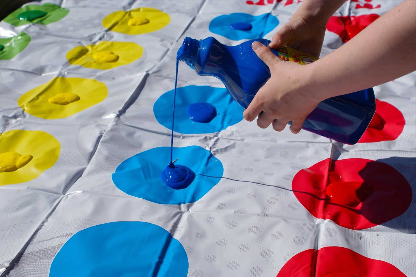 play messy twister! put paint or colored shaving cream on each spot for a fun twist on the classic twister game!