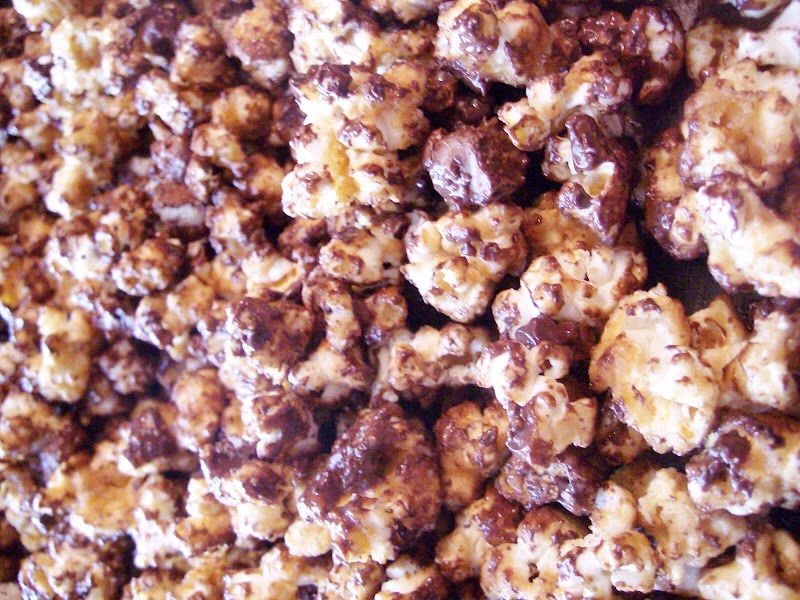 Let the popcorn sit until chocolate hardens, about 30 minutes. Store at room temperature in an airtight container. (We couldn't wait and ate it right away, messy but so good.)