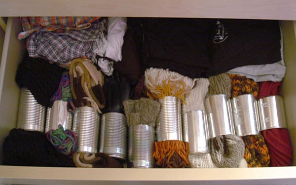 You can use tin cans or toilet paper rolls to keep yarn in tact
