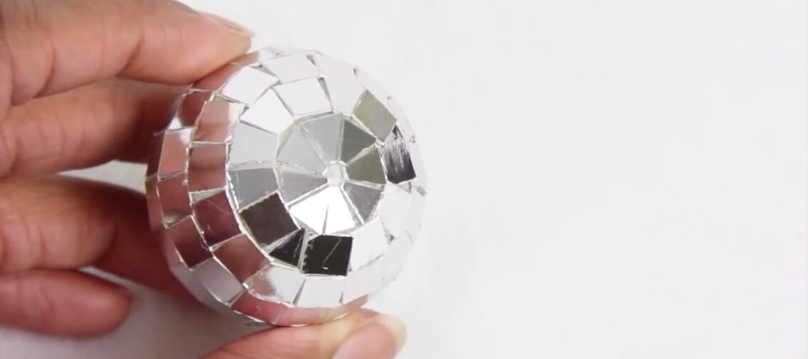 You may have to cut the squares into a different shape to fill the ball