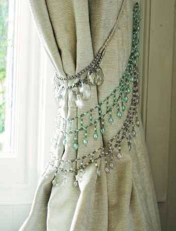 Use necklaces or brackets to tie back Curtains for a More chic look.