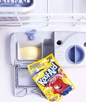 Lemonade Kool-Aid as Dishwasher Cleaner Clean lime deposits and iron stains inside the dishwasher by pouring a packet of lemonade Kool-Aid (the only flavor that works) into the detergent cup and running the (empty) dishwasher. The citric acid in the mix wipes out stains; you don't have