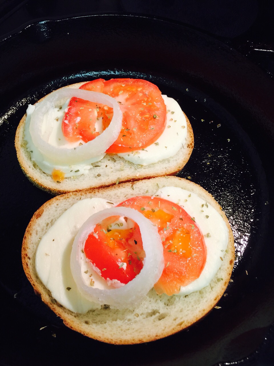 Sweet onion slices on top of tomatoes * add your choice of herbs - I chose oregano! 😋