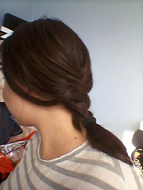 Braid your hair at the back of your neck.  It will be loose and soft because your hair is short but looks quite summery.