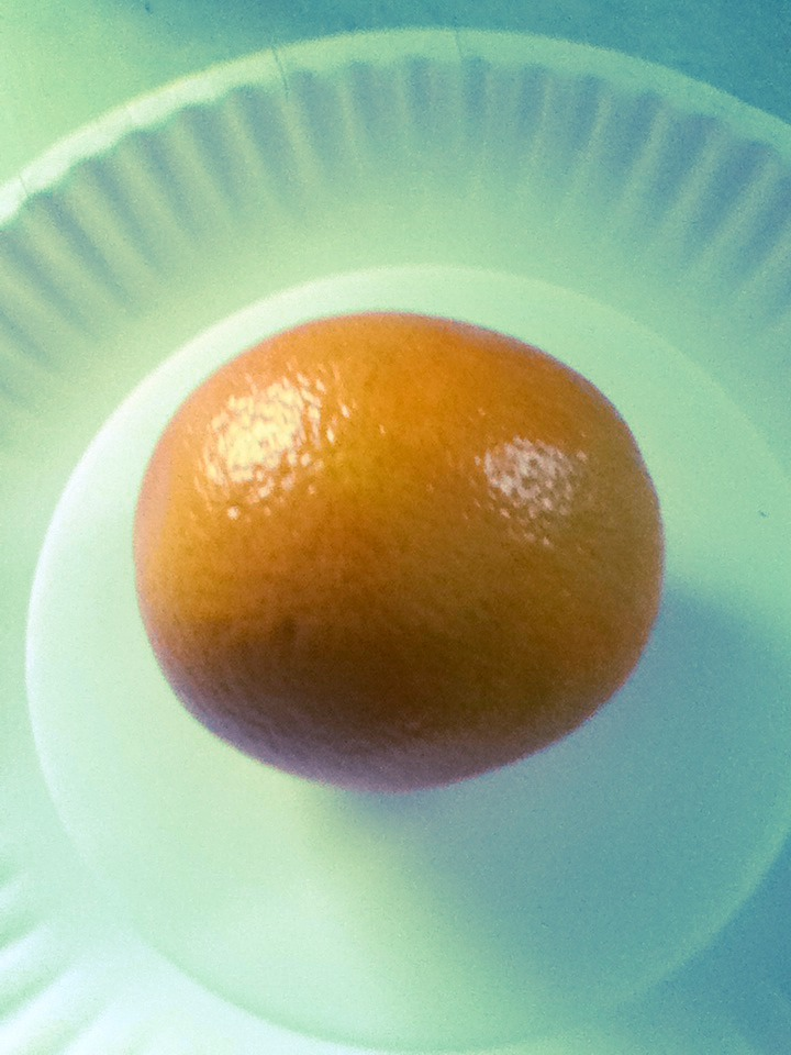 Take you orange and cut it in half; then take a half and cut into 4ths take off the peel.