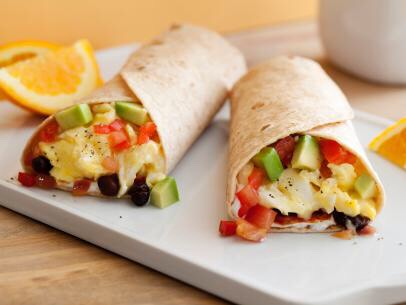 Breakfast burritos can easily be made healthy. Pack whole grain wraps full of beans, eggsand grilled veggies, and topthem off with homemade salsa and a dollop of plain Greek yogurt for a deliciously savory breakfast!