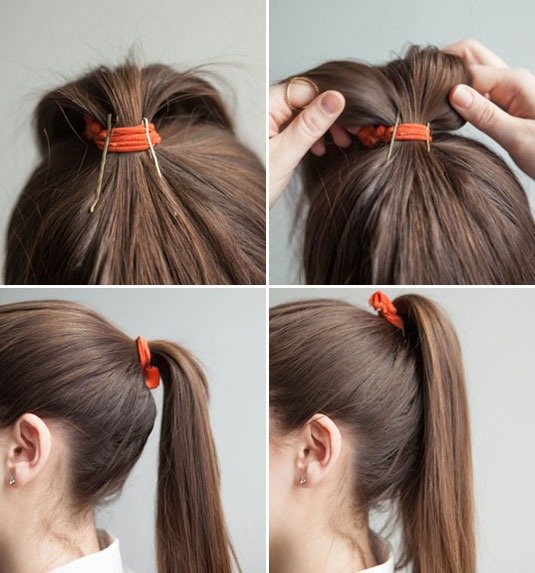 14. Insert bobby pins into your ponytail holder vertically to prop up your ponytail. Once you've put your hair in a ponytail, insert two or three bobby pins halfway inside the elastic and facing downward toward the crown of your head. Then, fluff your ponytail and flip it over for a fuller look.