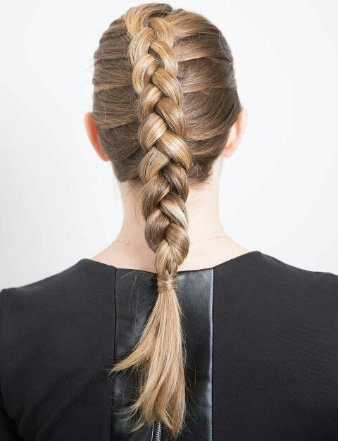 To create an inside-out French braid (note: this is also how you braid cornrows), repeat all the steps above, but then when you begin braiding, cross the sections of hair underneath one another, rather than over each other.