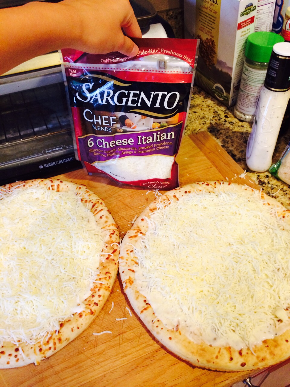 Now add 2-3 handfuls of sargento's 6 cheese Italian per 1 pizza crust.