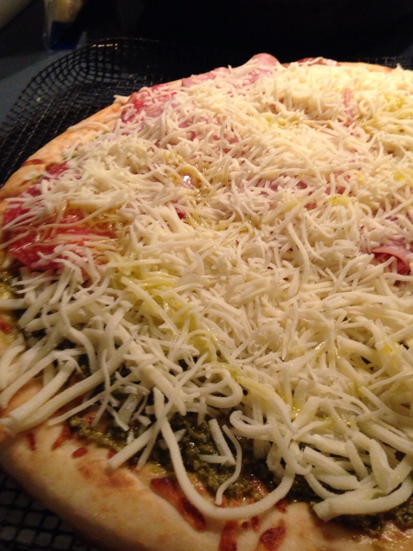 Add any meat or veggies you want then layer with more cheese.  Place in the oven.