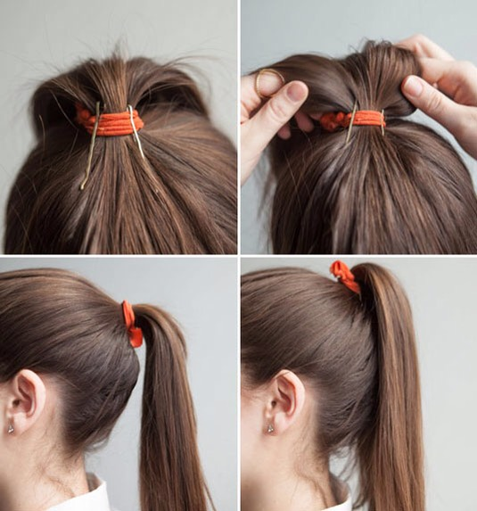 2.Insert bobby pins into your ponytail holder vertically to prop up your ponytail.  Put your hair in a ponytail, insert 2 or 3 bobby pins halfway inside the elastic & facing downward toward the crown of yourhead. Then, fluff your ponytail & flip it over for a fuller look that won't sag or droop.