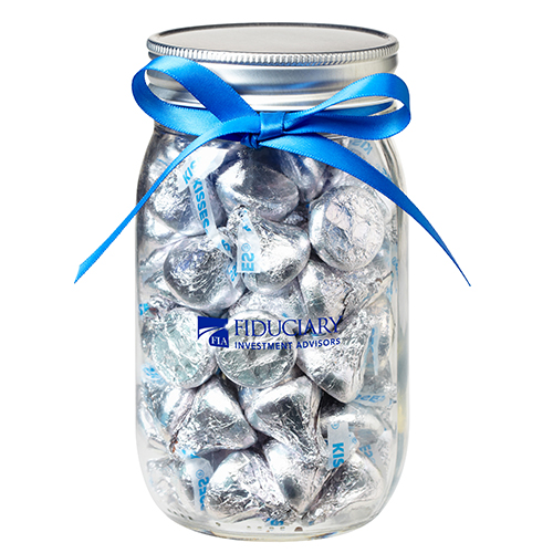 fill the jar with 100 candies (in this case kisses) AND have a extra small bag of kisses on the side.
