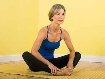 Butterfly stretch. Keep back straight and pull face to feet. bend neck and curve spine when your as far as you can go but don't come up to do this.