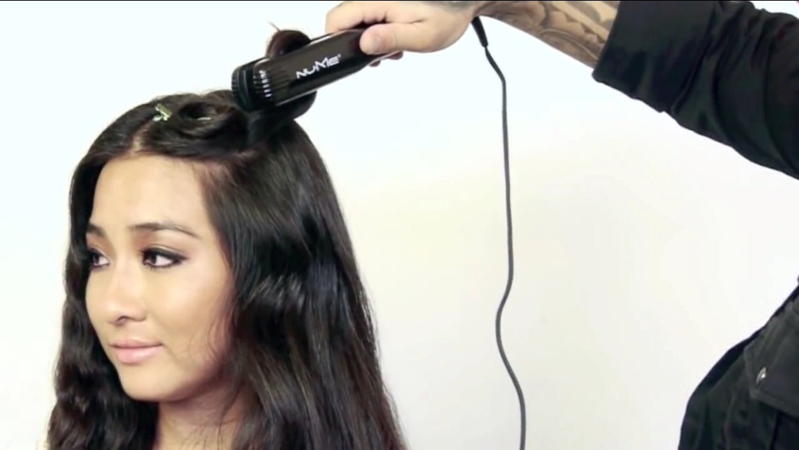 Roll up piece of hair into a circle. Clamp straightener onto hair for about 6-10 seconds depending on your hair type.