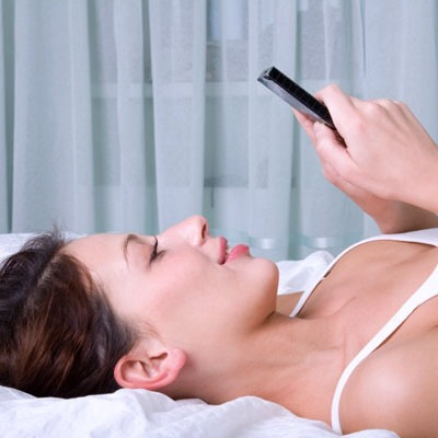 """Ban your phone! Need to send out one last e-mail before you """"officially"""" turn in? Not so fast. Typing in bed can wind you up, so when you do unplug, it will be harder to fall asleep."""