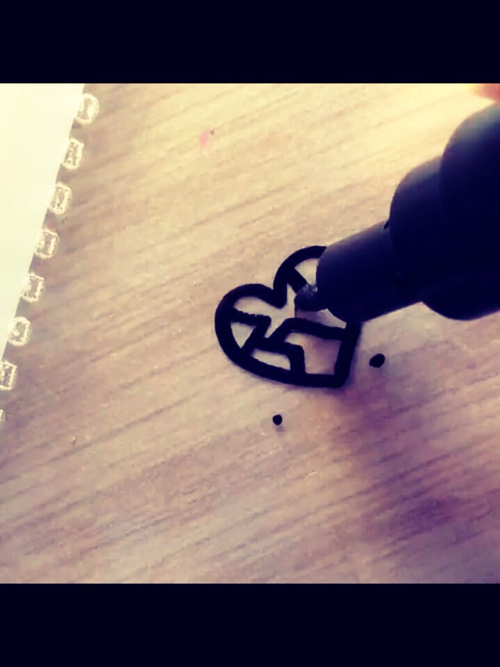 Draw any shape on the piece of plastic with the paint/ sharpie marker that will easily fit into your nails