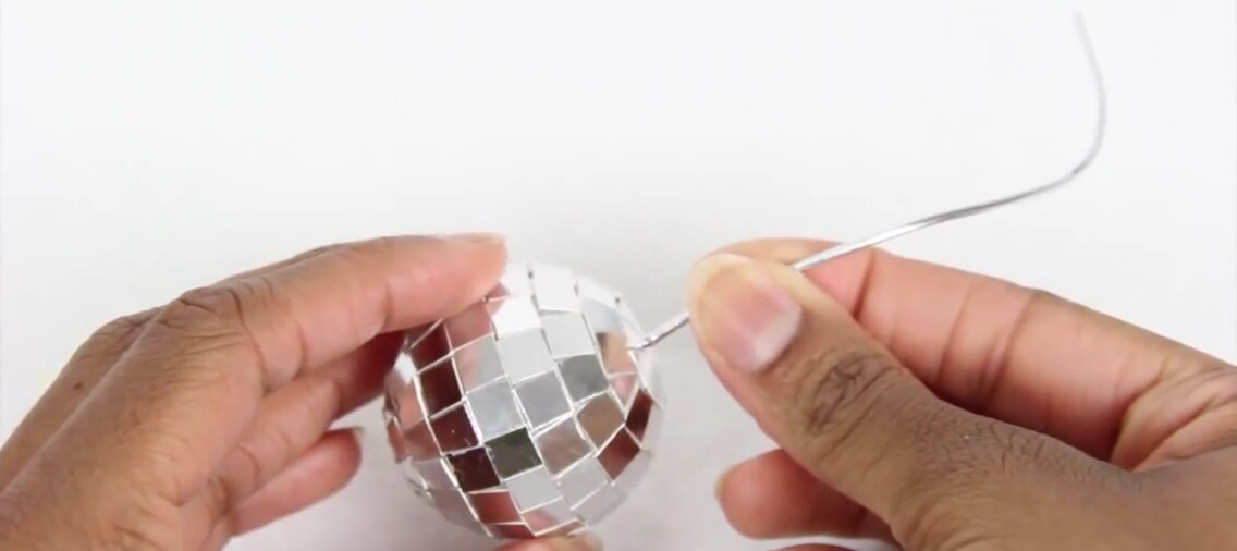 Glue the cord onto the top of the ball and your second design is done!