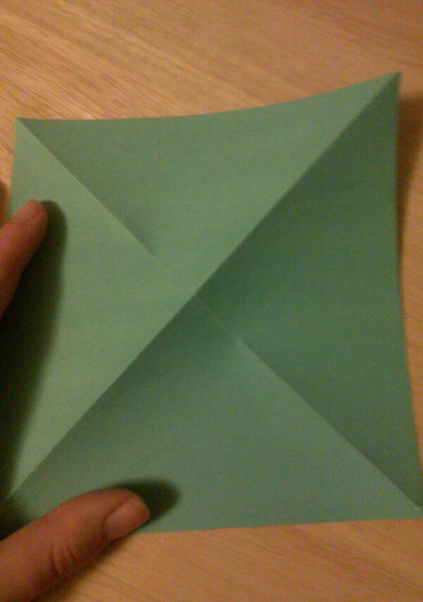 Step 1:  Start off with a square sheet of paper. fold the paper into a triangle. unfold. rotate and repeat. it should look like this