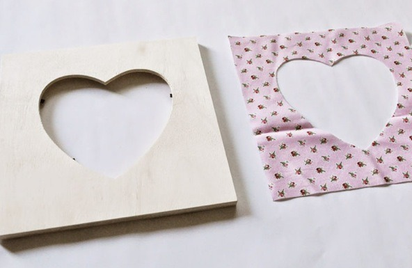 2. Using your scissors, cut out the shape of your frame on your fabric. Be precise as possible.