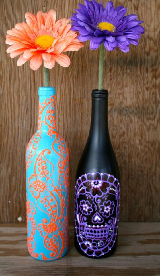 keep old beer and wine bottles and paint them and put little designs on them for a cute festive pop of color to any room