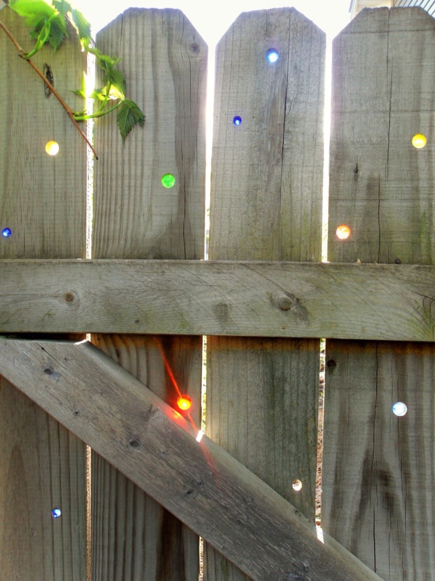 Just drill holes in the fence and secure marbles for a cool stained class look