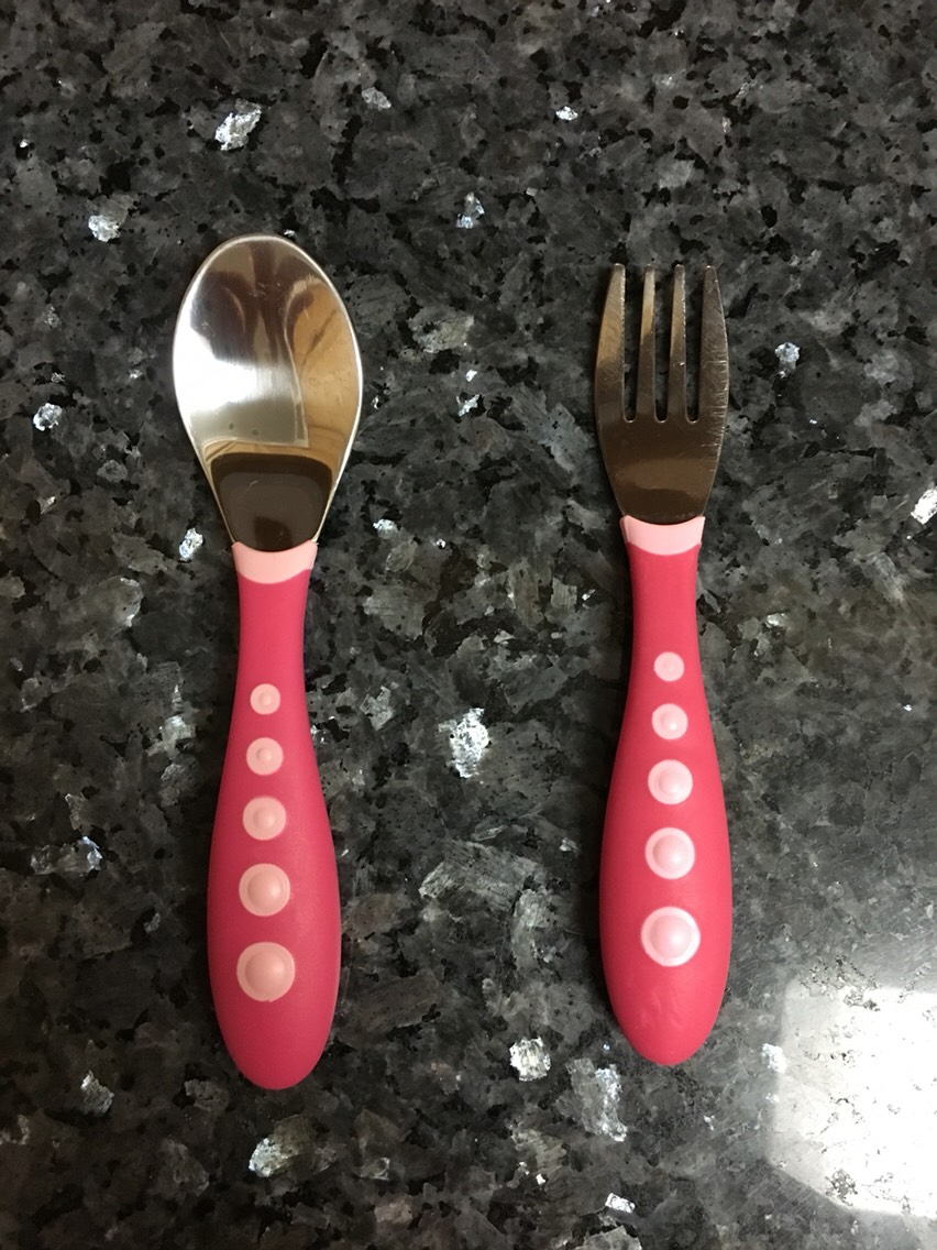 My toddler seemsto control these easy grip utensils made by Gerber better than any other. I got this set on Anazon. The more sets you buy the cheaper it is!!!!!