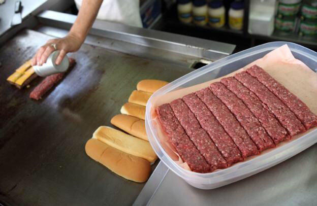 Roll the hamburger meat into a hot dog shape (note: the dog will shrink when cooked so make it longer than a normal hot dog)