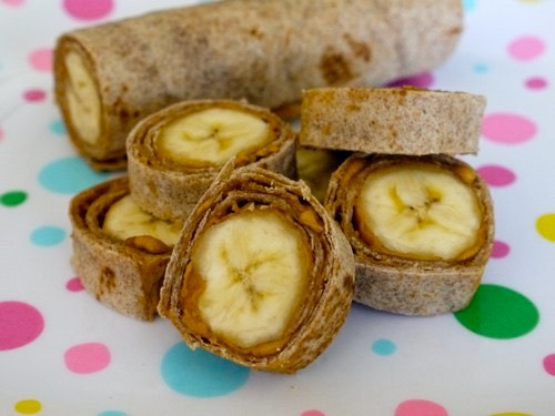 Wholewheat tortilla with peanut butter and banana sushi bites - fun super tasty snack great for kids too