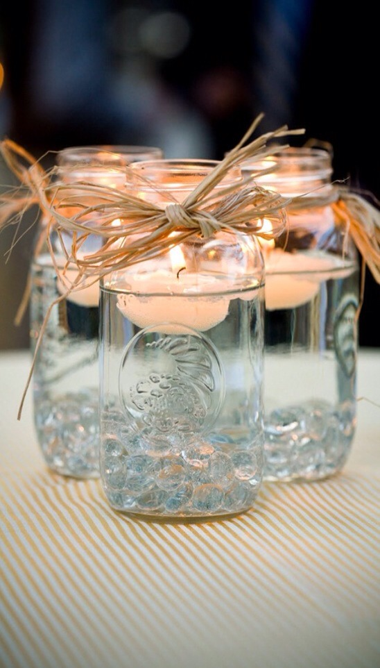 Floating candle jar I really want this. Especially with a beeswax candle. Well these things are pretty easy to make! http://emmalinebride.com/handmade-wedding/mason-jar-centerpieces-floating-candles/#more-24961