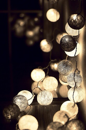 Beautiful elegant lights. Just make an x in the Ping pong ball and insert the Christmas tree light inside. Then hang for a beautiful effect.