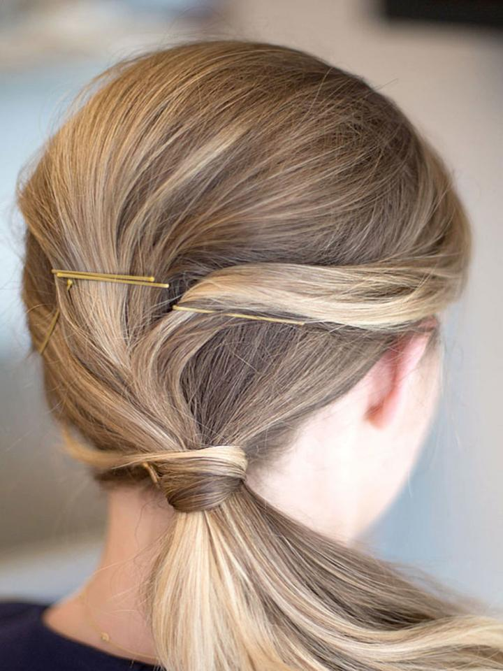 7. Twist your hair over to one side for a cute twist on the side ponytail. Use bobby pins to hold into place.