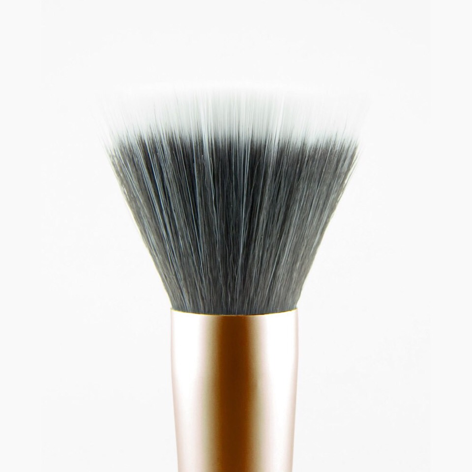 The problem with using foundation brushes on dry skin is the it can exfoliate the skin more causing it to look dryer and appearance of dry flakey skin. But if you don't want to part from your makeup brushes try a 'finishing brush'. It is very soft and it kinder to the skin. Apply in dabbing motions