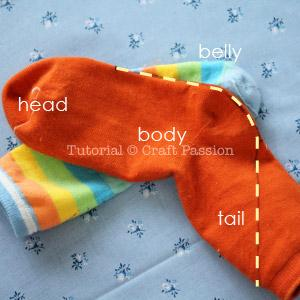 Place the solid color adult sock on a toddler stripe sock as shown in the picture. Mark the seam line on the adult sock as indicated in yellow dash line.