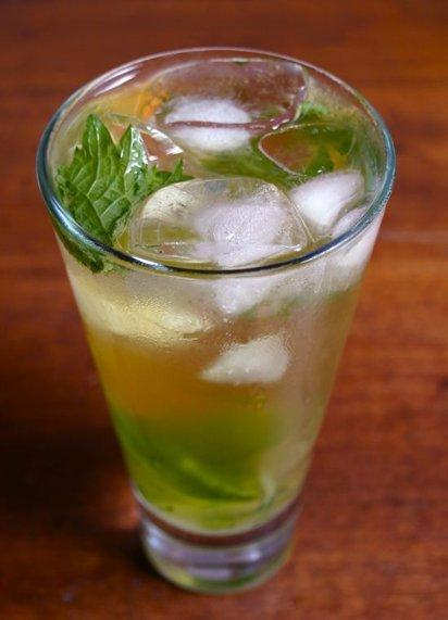 Green Tea Mojito  (adapted from Organic, Shaken and Stirred by Paul Abercrombie)  makes one drink 1 tablespoon fresh lime juice 4 large mint leaves (I substituted 1 shiso leaf, torn into several large pieces) 2 teaspoons sugar approx. 1/2 cup brewed green tea, chilled 1 ounce white rum  Mu