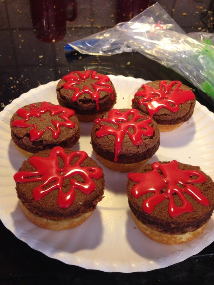 1.Bake the cupcakes in non stick muffin tins(only fill about 1/2 of the well)  2.Spread out the brownie batter to about 1/2-3/4 of an inch 3.When cooled, carefully cut the cupcakes in half  4.Use a round cookie cutter to cut out the brownie patties  5.Use red, green and yellow icing to decorate