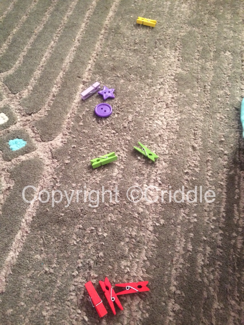 Ask your toddler to sort all the different objects you place out into colour groups :-)