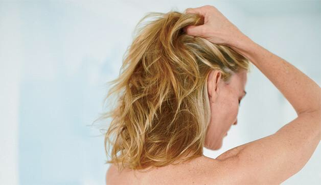 Massage the olive oil into your scalp for about 2 minutes.