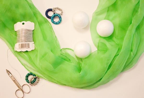 what you'll need: Scarf (I used this one) Medium-sized styrofoam balls Thread Decorative rings Scissors