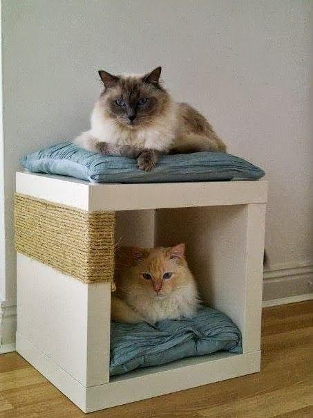 14. Tie sisal rope around an Expedit single shelving unit to create a scratch post and cat bed in one.