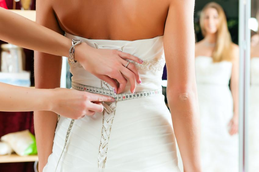 Factor in alteration and cleaning costs.  You may find a fabulous dress in your price range, but don't forget to consider the couple hundred dollars it might cost to get it professionally cleaned and altered.