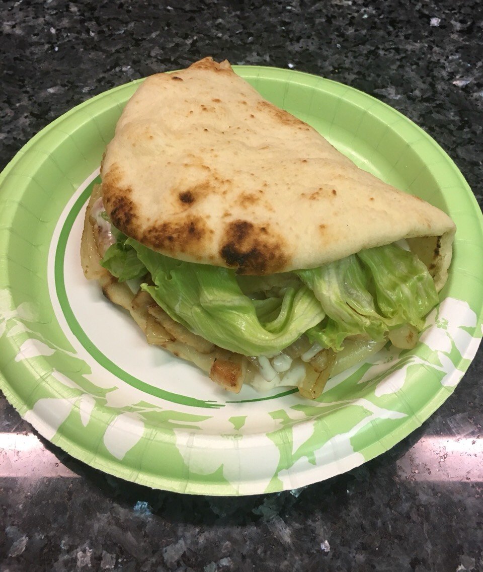 You will need for one sandwich: Flatbread 1 boneless chicken breast 2 slices provolone cheese Onion to your own liking Ranch dressing Lettuce to your own liking