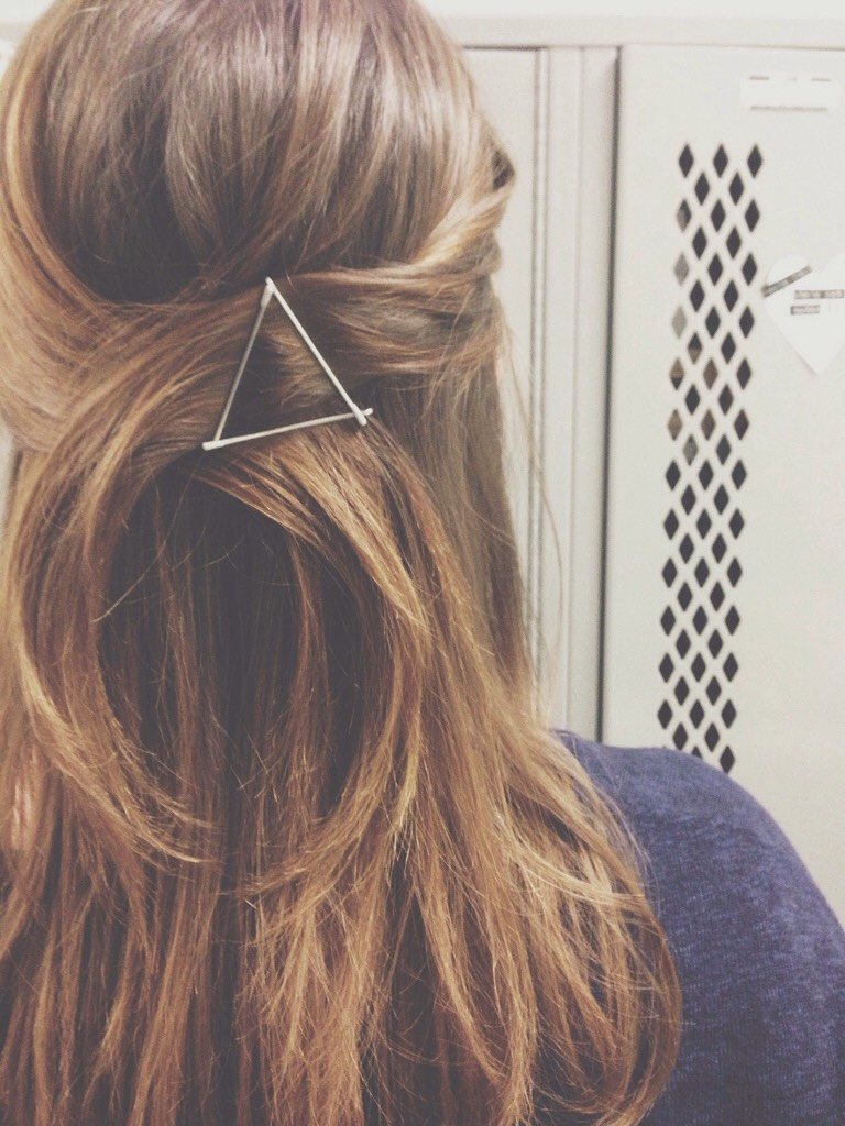 pull your hair back and then take out 3 bobby pins and shape it into a triangle