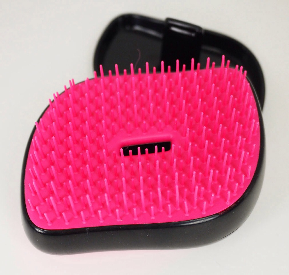 Invest in a detangling hair brush. I was skeptical at first, but they really do work. Most hair brushes just break and rip your hair instead of actually getting the knots out. You could also use a wide tooth comb but it is a little more difficult to use. You don't have to spend much mine was only $4