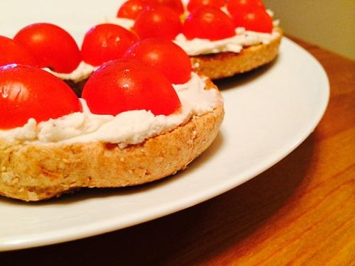 Toast another whole-grain bagel and add delicious vegan cream cheese! I used GO Veggie! brand. Smear it on, add some sliced cherry tomatoes, and enjoy this refreshingly simple lunchtime munch.
