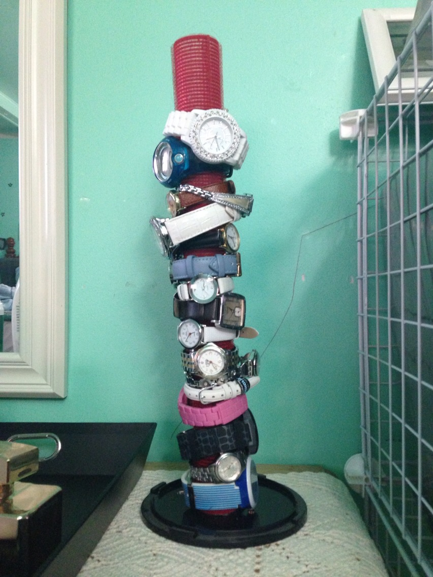 glue together unused hair curlers and a CD spindle to create a display for watches.
