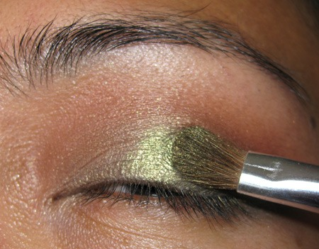 Then add a matte brown eyeshadow to your crease and blend throughout. You can either apply the green shadow first, or the brown color. It doesn't matter as long as it is all blended evenly