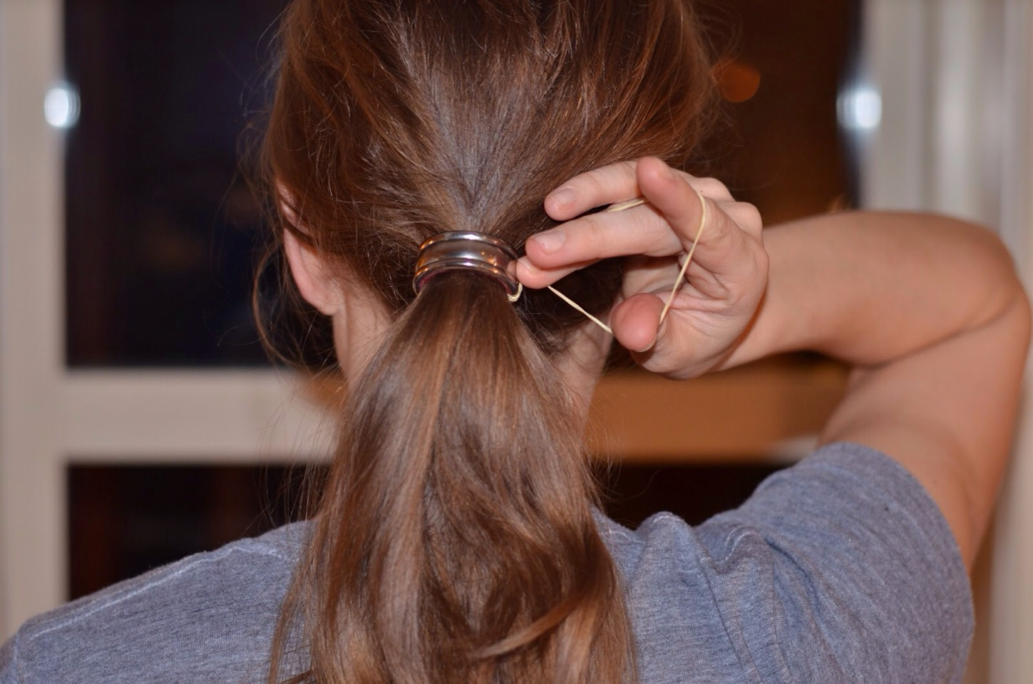 Don't ever use rubber band to hold up a ponytail, it can cause breakage and split ends